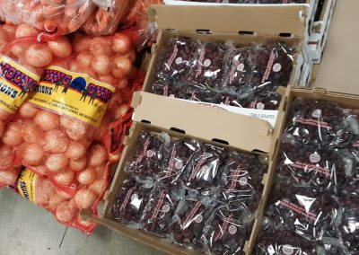 Shipment of grapes and onions