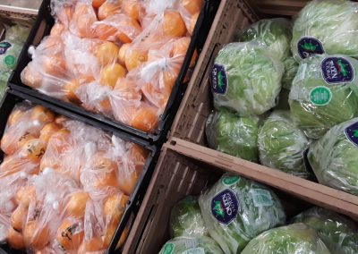 Cabbages and oranges in crates